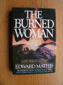 The Burned Woman: A Dan Roman Mystery